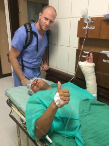 Dr. Moss visiting a patient just after wrist surgery.